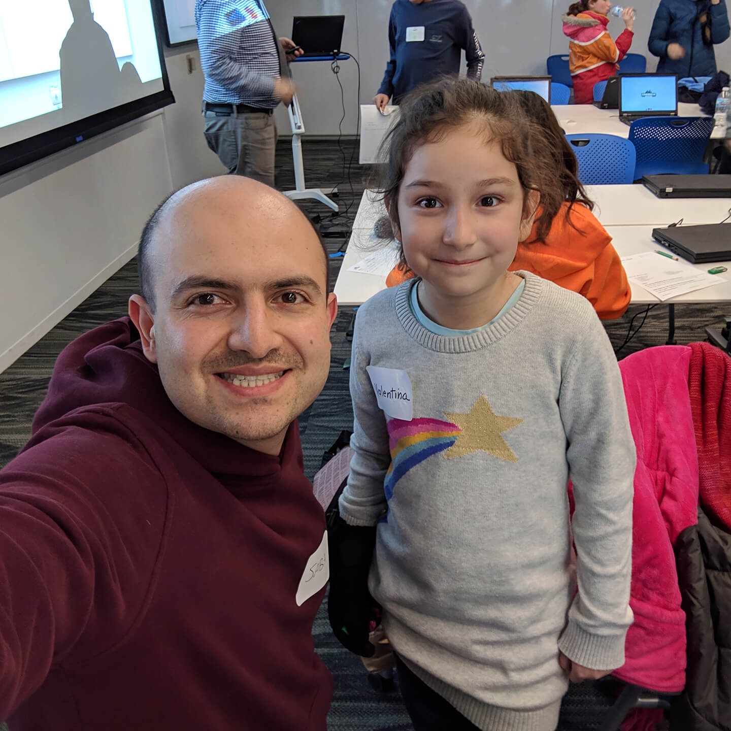 Photo of student and mentor in class.